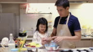 Father Make a sweet food with Daugther video
