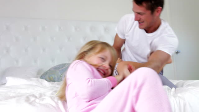 Father Playing On Bed With Children video