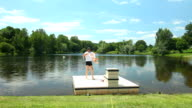 Father playing with daughter on floating platform video
