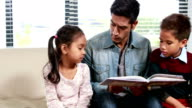 Father reading his kids a story video
