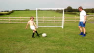 Father & Son passing football / soccer video