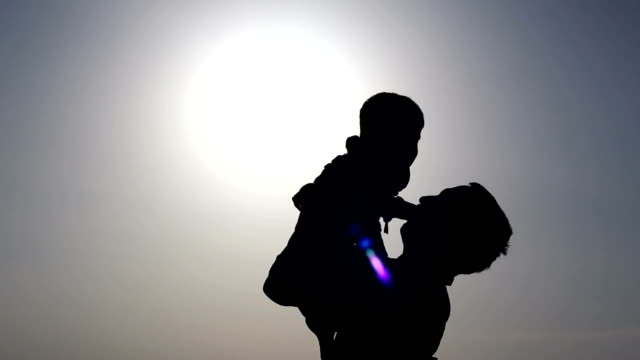 Father & son playing silhouette outdoor video