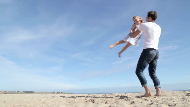 Father Spinning Daughter Round on the Beach video