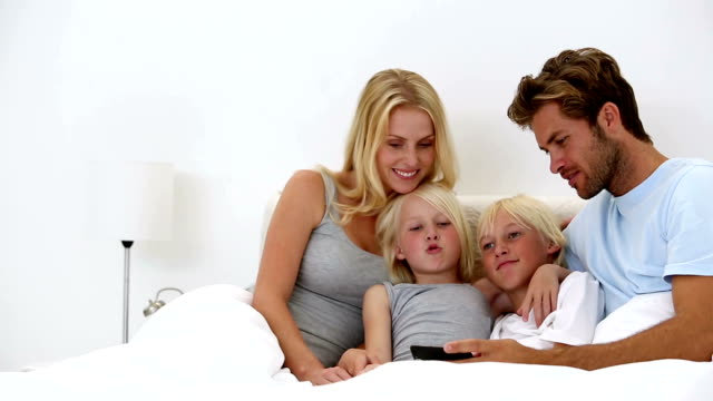 Father taking self portrait of him with happy family video
