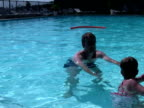 Father Teaching Child to Swim; Swimming from Pool Edge video