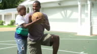 Father Teaching Son To Play Basketball At Home video