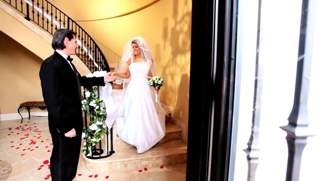 Father Watching Bride Descend Staircase video