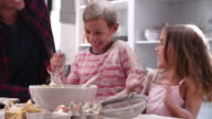 Father With Children Having Messy Fun Baking In Kitchen video