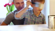 Father with Little son painting  table in white video