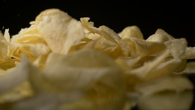 Fatty Unhealthy Chip Crisps food falling in slow motion video