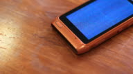 Faulty Phone Placed on Wooden Table video