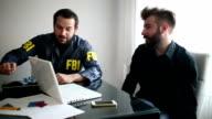 Fbi agent and businessman talking video