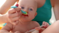feeding baby with a spoon video