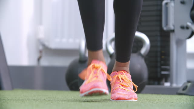 Feet of a woman jumping rope at a gym video