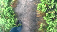 Feet of a young man hiking video