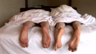 HD: Feet of Couple in Bed video