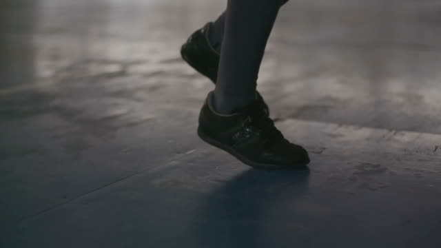 Feet of female boxer jumping rope video