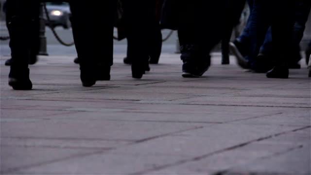 Feet of people walking. video