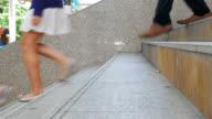 Feet of people walkingon overpass video