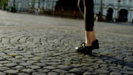 Feet of slim woman going in the street video