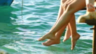 SUMMER REFRESHMENT CONCEPT. Feet playing in the sea water wave splashes video