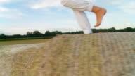 HD STEADY SHOT: Feet Running On Hay Bales video