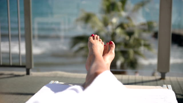 Feet up on the balcony with sea view video