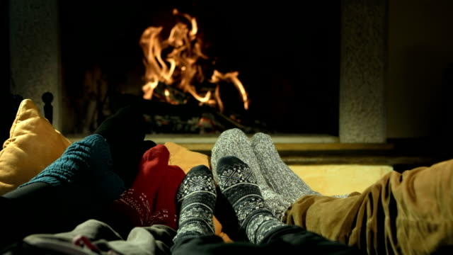 HD DOLLY: Feet Warming At Fireplace video
