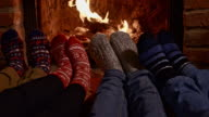 DS Feet warming by fireplace video