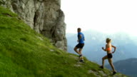 HD: Fell Runners Running Along Mountain Ridge video