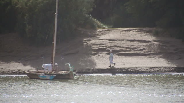 Felukka sailing boat on Nile, arriving at riverbank video