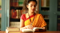 Female Academician in Library video
