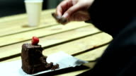 Female addict to sweets eating high calorie chocolate cake, unhealthy video