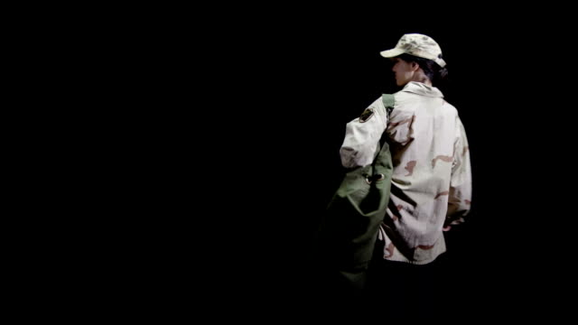 Female Army  soldier black background video