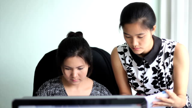 Female Asian Office Workers Enjoying A Busy Day video