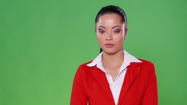 4K Female asian presenter on green background video