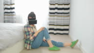Female at home wearing virtual reality gear. video