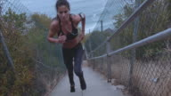 Female athlete climbing up the steps video