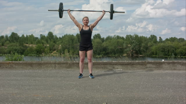 Female athlete doing crossfit deadlifts outdoors video