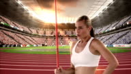 Female athlete standing with javelin throw video