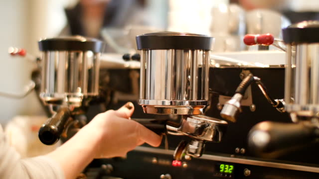 Female barista making cup of coffee in cafe video