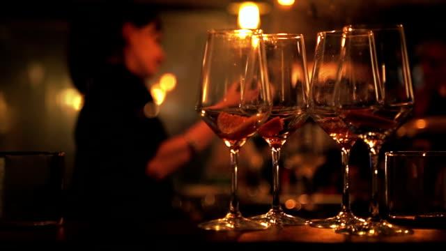 Female bartender pouring vine in glass video