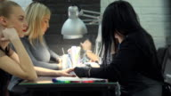 Female beauticians do different procedures and services in beauty salon. video