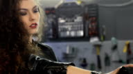 Female biker leans back on the motorcycle seat video