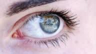 female blue eye closeup footage video
