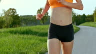 SLO MO TS TU Female body in running motion video
