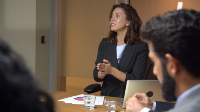 Female boss chairing a business meeting in a boardroom video
