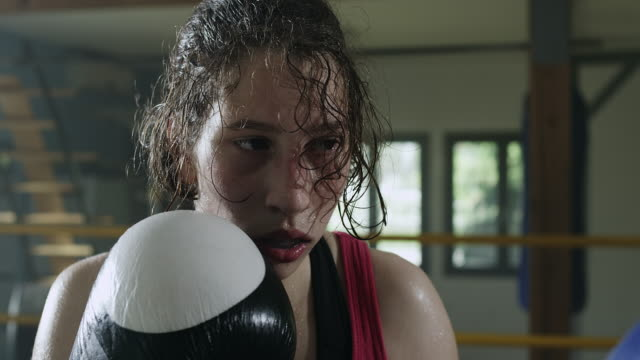 Female boxer boxing in the ring video