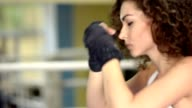 female boxer shadow boxing on the ring, close-up video