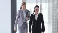 SLO MO Female business colleagues shaking hands in hallway video
